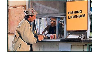 Man paying for fishing license