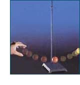 Red ball on pendulum hits yellow ball and starts it