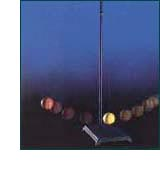 Yellow ball on pendulum hits red ball swinging back