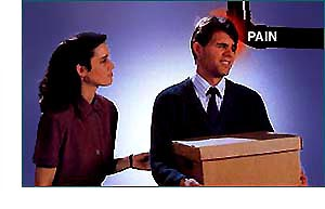 Woman getting man to perform contact assist with a box in his hands